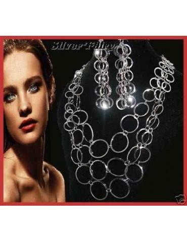 Parure '70 stile colore argento con i cerchi : Collana e Orecchini
